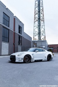 White Nissan GT-R with huge black rims.
