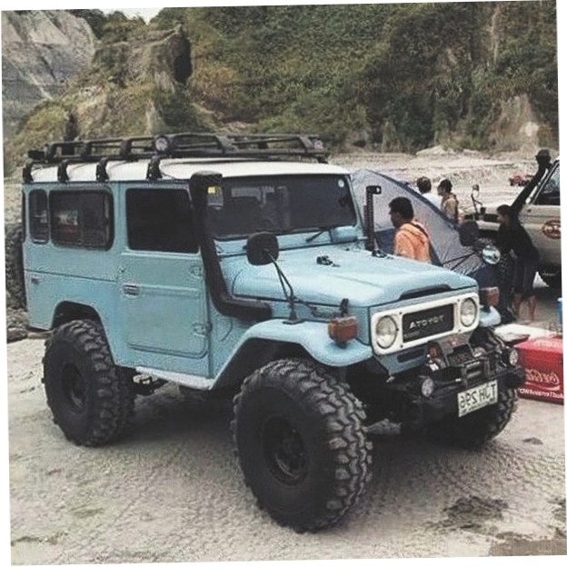 Light Blue Toyota Land Cruiser Bj44 On Beach With Snorkel